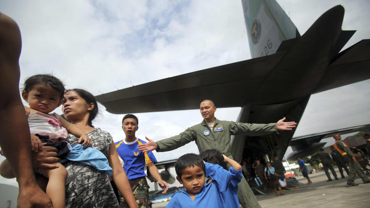 Survivors of Typhoon Haiyan disembark a Philippine Airforce C-130 aircraft at Villamor Airbase, Tuesday, Nov. 12, 2013 in Manila, Philippines. Authorities said at least 9.7 million people in 41 provinces were affected by the typhoon, which was likely the deadliest natural disaster to beset this poor Southeast Asian nation. (AP Photo/Wong Maye-E)