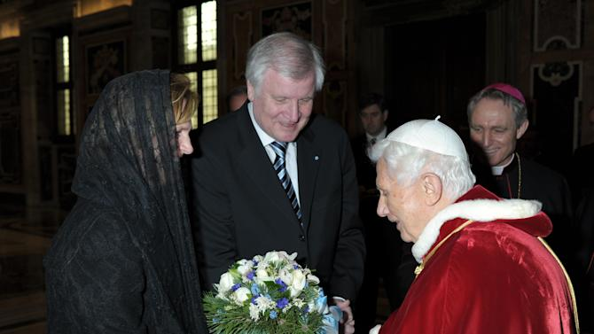 "In this photo released by the Vatican newspaper L'Osservatore Romano, Pope Benedict XVI receives German politician Horst Seehofer and his wife Karin during a private audience which followed his last general audience, at the Vatican, Wednesday, Feb. 27, 2013. Benedict XVI basked in an emotional sendoff Wednesday at his final general audience in St. Peter's Square, recalling moments of ""joy and light"" during his papacy but also times of great difficulty. He also thanked his flock for respecting his decision to retire. (AP Photo/Osservatore Romano, ho)"