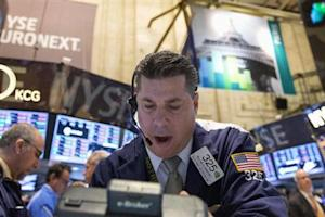 Trader William McInerney works on the floor of the New York Stock Exchange February 27, 2014. REUTERS/Brendan McDermid