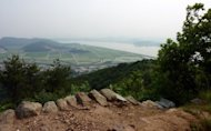 An area near the Demilitarised Zone (DMZ) can be seen from the Munsu mountain fortress at Gimpo. An unlikely and unique cradle of biodiversity that runs the length of the world's most heavily-militarised border is being threatened by encroaching development, conservation experts say