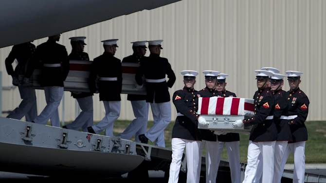 Carry teams move flag draped transfer cases of the remains of the four Americans killed this week in Benghazi, Libya, from a transport plane during the Transfer of Remains Ceremony, Friday, Sept. 14, 2012, at Andrews Air Force Base, Md., marking the return to the United States of the remains of the four Americans killed this week in Benghazi, Libya. (AP Photo/Carolyn Kaster)