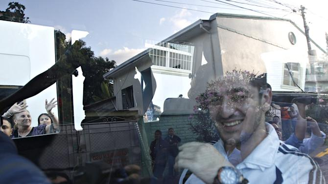 One of five Syrian men is seen inside a bus after he leaves a court room after they were freed from jail in Tegucigalpa