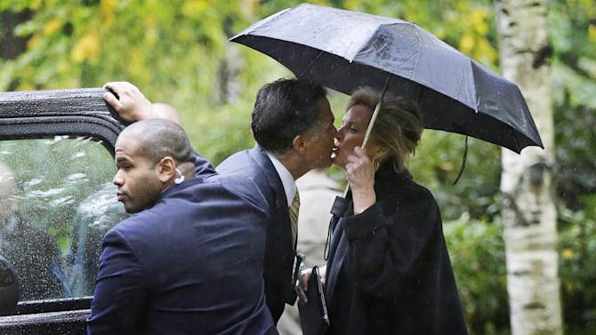 Republican presidential candidate and former Massachusetts Gov. Mitt Romney kisses wife Ann as he leaves the Church of Jesus Christ of Latter-day Saints in Belmont, Mass., Sunday, Oct. 14, 2012. (AP Photo/Charles Dharapak)