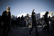 Shiite protestors clash with security forces following a protest to mark the second anniversary of an uprising in the Sunni-ruled kingdom of Bahrain in Sanabis on February 14, 2013. Bahrain's opposition called a rally near Manama marking the second anniversary of a Shiite-led uprising against the kingdom's Sunni rulers, a day after two people died when protests turned violent