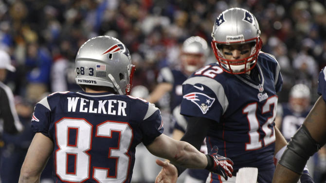 New England Patriots wide receiver Wes Welker (83) is congratulated by Tom Brady after catching a one-yard touchdown pass during the first half of the NFL football AFC Championship football game against the Baltimore Ravens in Foxborough, Mass., Sunday, Jan. 20, 2013. (AP Photo/Stephan Savoia)