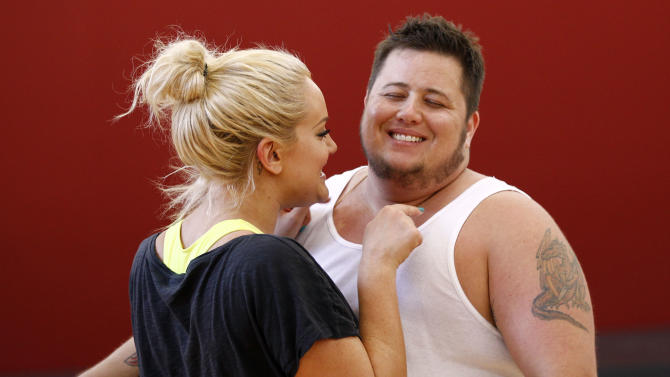 """In this Sept. 7, 2011 photo, Chaz Bono, right, and his dance partner Lacey Schwimmer laugh while rehearsing for the upcoming season of """"Dancing of the Stars"""" in Los Angeles. The new season of """"Dancing with the Stars"""" premieres Monday, Sept. 19 on ABC. (AP Photo/Matt Sayles)"""