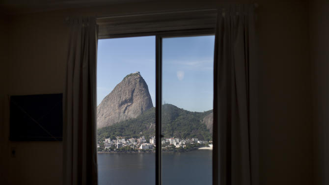 In this May 23, 2012 photo, Sugarloaf mountain is visible from an apartment in the Flamengo neighborhood of Rio de Janeiro, Brazil. Brazil's burgeoning middle class is moving up in the world, into fancier high-rises. The discovery of vast oil deposits off the coast has flooded the city with renters carrying fistfuls of petrodollars. And property owners already are hiking rents in anticipation of Rio's upcoming mega-events, the 2014 soccer World Cup and 2016 Olympics. (AP Photo/Felipe Dana)