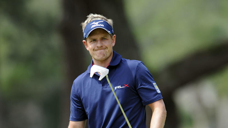 Luke Donald, of England, reacts after missing a birdie putt on the 10th green during the final round of the RBC Heritage golf tournament in Hilton Head Island, S.C., Sunday, April 21, 2013. (AP Photo/Stephen Morton)