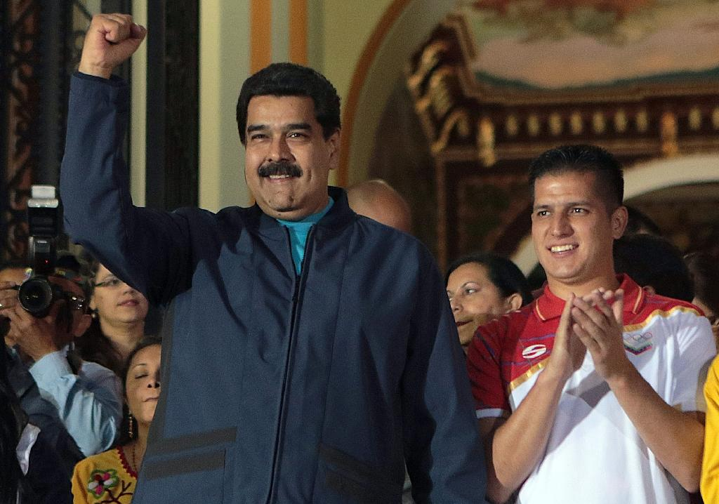 Venezuela leader gets emergency powers, rivals vow ouster