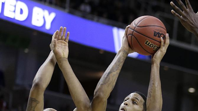 California guard Allen Crabbe (23) shoots against UNLV guard Bryce Dejean-Jones (13) during the first half of a second-round game in the NCAA college basketball tournament in San Jose, Calif., Thursday, March 21, 2013. (AP Photo/Ben Margot)