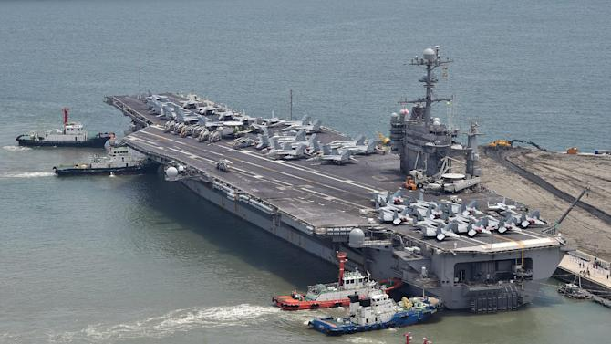 US aircraft carrier the USS George Washington arrives at the southeastern port city of Busan, South Korea on July 11, 2014