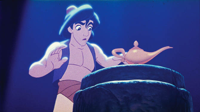 """This undated publicity photo provided by Disney Theatrical Productions shows Aladdin with a lamp in a scene from the 1992 animated film, """"Aladdin."""" A stage musical of """"Aladdin"""" is riding a magic carpet to Broadway and the president of Disney Theatrical Productions promises it will be """"a full-length, big song musical with big dance numbers.""""  Thomas Schumacher said on Friday, Jan. 18, 2013, that the final two-act """"Aladdin"""" will build on the 1992 film blockbuster with new songs by Alan Menken, additional characters and, appropriately, some magic tricks. (AP Photo/Disney Theatrical Productions)"""
