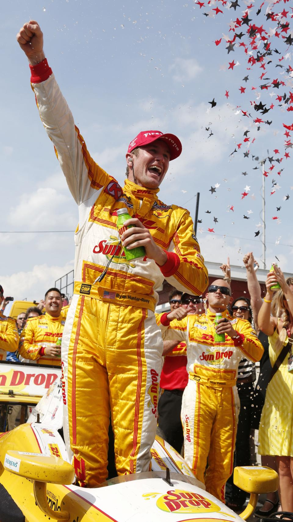 Ryan Hunter-Reay celebrates after winning the IndyCar auto race at the Milwaukee Mile in West Allis, Wis., Saturday, June 16, 2012. (AP Photo/Jeffrey Phelps)