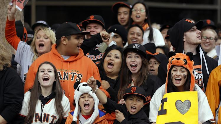 Fans cheer at the start of the San Francisco Giants World Series victory parade, Wednesday, Oct. 31, 2012, in San Francisco. The Giants swept the Detroit Tigers in three games to win the World Series. (AP Photo/Marcio Jose Sanchez)