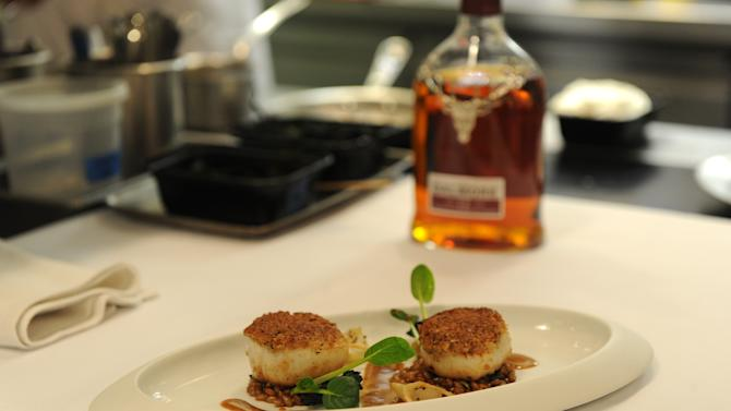 IMAGE DISTRIBUTED FOR THE DALMORE - Seared sea scallops featuring a whisky glaze are photographed in the kitchen of DANIEL, Tuesday, April 23, 2013, in New York, to celebrate the launch of The Dalmore Selected by Daniel Boulud.  His bespoke whisky is now available at: DANIEL, CafÈ Boulud, Boulud Sud, db Bistro Moderne, Bar Boulud and DBGB Kitchen & Bar. (Photo by Diane Bondareff/Invision for The Dalmore/AP Images)