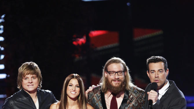 """This Monday, Dec. 17, 2012 file photo released by NBC shows host, Carson Daly, right, with the three finalists, from left, Terry McDermott, Cassadee Pope and Nicholas David, on """"The Voice,"""" """"Live Show"""" Episode 323A on the part one season 3 finale in Los Angeles.  The contestants vie for the title in the NBC reality show on Dec. 18. (AP Photo/NBC, Tyler Golden)"""