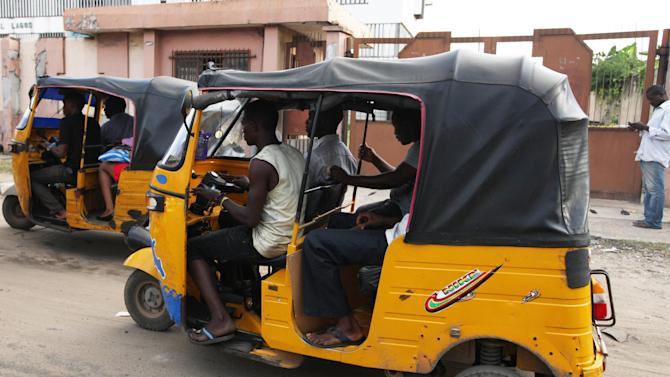 "An unidentified man, wears a sleeveless t-shirt and a cutoff pants, as he drives a a rickshaw, in Lagos, Nigeria. Monday, Oct. 14, 2013. Cutoff pants displaying a bulging calf? Sleeveless T-shirts showing off a well-muscled physique? Forget it in Nigeria's northern Kano state, where Islamic police are deploying thousands of officers to arrest anyone sporting the ""indecent dress"" that's fashionable among young men driving motorized rickshaw taxis. (AP Photo/Sunday Alamba)"