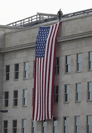 A security officer walks on the roof ahead of the start of ceremonies for the 10th anniversary of the September 11 attacks at the Pentagon in Washington, Sunday, Sept. 11, 2011. (AP Photo/Charles Dharapak)