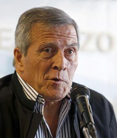 Tabarez gestures during a news conference after he is confirmed as head coach of Uruguay's national soccer team for the third consecutive time at the AUF in Montevideo