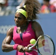 Serena Williams returns a backhand against Ekaterina Makarova of Russia during their 2012 US Open women&#39;s singles match at the USTA Billie Jean King National Tennis Center in New York. Williams won 6-4, 6-0