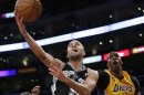 San Antonio Spurs Parker of France is fouled by Los Angeles Lakers Howard as he goes up to shoot during Game 3 of their NBA Western Conference Quarterfinals basketball playoff series in Los Angeles