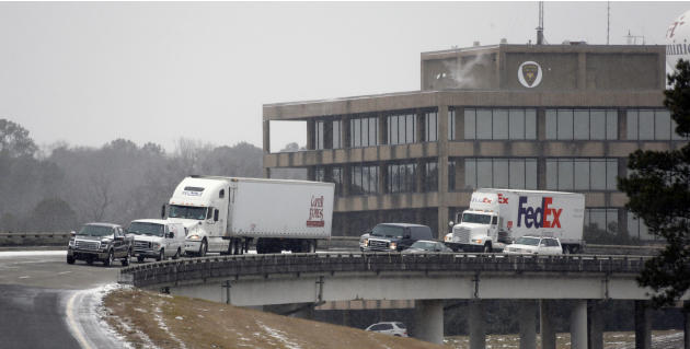Traffic creeps along Interstate 55 South as ice and snow flurries