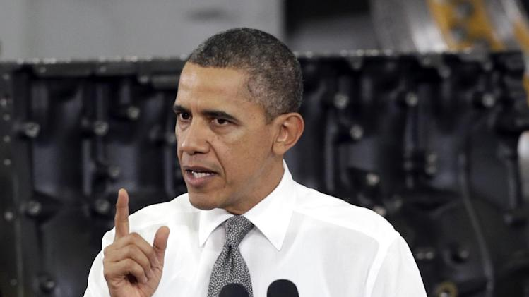 President Barack Obama gestures as he speaks to workers and guests at the Linamar Corporation plant in Arden, N.C., Wednesday, Feb. 13, 2013, as he travels after delivering his State of the Union address Tuesday. (AP Photo/Chuck Burton)