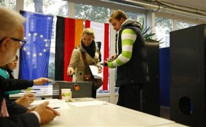 Voters cast their ballots at the polling station where…