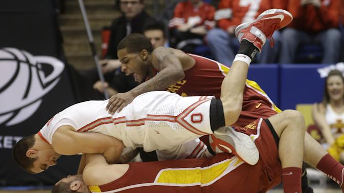 Iowa State forward Georges Niang (31) and guard Korie Lucious, top, struggle with Ohio State guard Aaron Craft for a loose ball in the first half of a third-round game of the NCAA college basketball tournament, Sunday  March 24, 2013, in Dayton, Ohio. (AP Photo/Al Behrman)