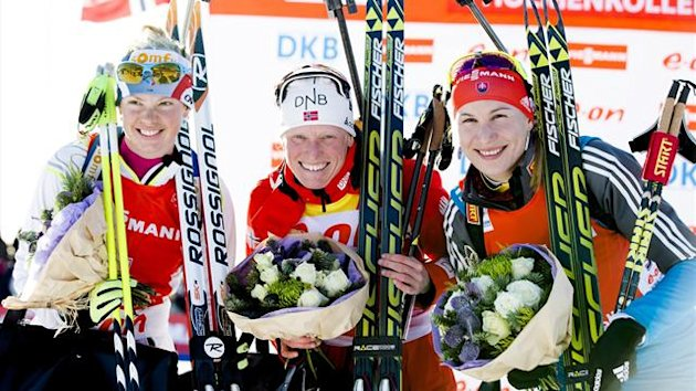 First placed Tora Berger (C) of Norway, second placed Marie Dorin Habert (L) of France and third placed Anastasiya Kuzmina of Slovakia smile on the podium after winning the women&#39;s 10 km pursuit race at the Biathlon World Cup in Oslo (Reuters)