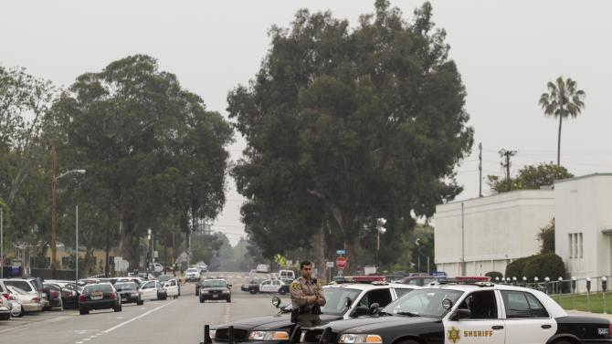 A Los Angeles County Sheriff's officer stands guard in Santa Monica, Calif. on Saturday, June 8, 2013 near the scene of a deadly shooting in Santa Monica College on Friday. (AP Photo/Ringo H.W. Chiu)