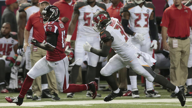 Atlanta Falcons wide receiver Devin Hester (17) runs by Tampa Bay Buccaneers free safety Keith Tandy (37) during the first half of an NFL football game, Thursday, Sept. 18, 2014, in Atlanta. (AP Photo/John Bazemore)