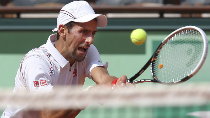 Novak Djokovic of Serbia returns in his first round match against Potito Starace of Italy at the French Open tennis tournament in Roland Garros stadium in Paris, Monday May 28, 2012. (AP Photo/David Vincent)