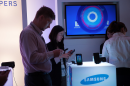Samsung postpones home-grown Tizen software