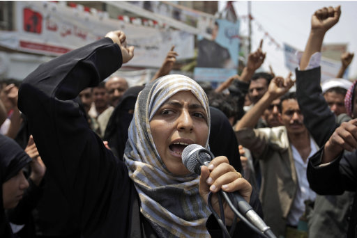 FILE - In this June 27, 2011 file photo, Yemeni activist Tawakkul Karman chants slogans along with anti-government protestors, during a demonstration demanding the resignation of Yemeni President Ali Abdullah Saleh, in Sanaa, Yemen. Liberian President Ellen Johnson Sirleaf, Liberian activist Leymah Gbowee and Tawakkul Karman of Yemen have won the 2011 Nobel Peace Prize, the Norwegian Nobel Committee announced Friday, Oct. 7, 2011. (AP Photo/Hani Mohammed, File)