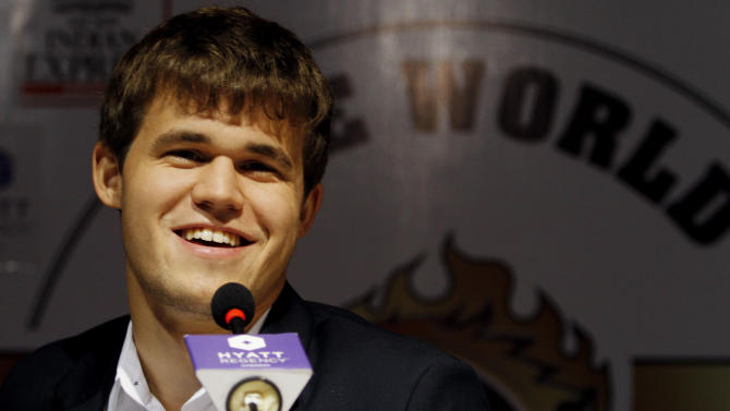 Norway's Magnus Carlsen smiles as he answers a question during a press conference after winning the match against India's Viswanathan Anand during the Chess World Championship match in Chennai, India, Friday, Nov. 22, 2013. Anand's reign as the world champion came to an end Friday after Carlsen took the crown in the tenth game of the the World Chess championship. (AP Photo/Arun Sankar K.)