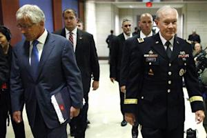 U.S. Defense Secretary Chuck Hagel (L) and Chairman of the Joint Chiefs of Staff U.S. Army General Martin Dempsey (R) arrive to brief members of Congress on proposed military action against Syria, at the U.S. Capitol in Washington, September 9, 2013. REUTERS/Jonathan Ernst