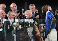 Italian forward Mario Balotelli (R) shakes hands with Italian Prime minister Mario Monti after the Euro 2012 football championships final match Spain vs Italy at the Olympic Stadium in Kiev. Spain confirmed their status as one of the greatest national teams in football history by overwhelming Italy 4-0 in Sunday&#39;s Euro 2012 final in Kiev to retain their European crown