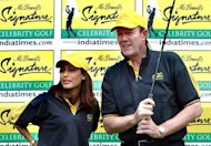 Former England cricket captain and TV commentator Tony Greig (R) poses with former Miss India Nafisa Joseph at a golf course in Bangalore, southern India, on September 12, 2003. Former England captains Ian Botham and Nasser Hussain have led the tributes to their late predecessor Greig, who died on Saturday at the age of 66