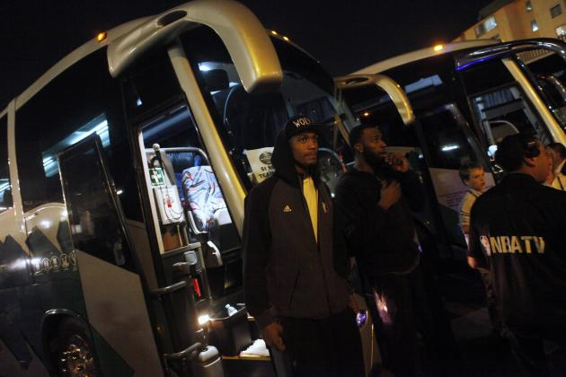 Minnesota Timberwolves players stand in front of their bus after a transformer exploded at the Mexico City Arena in Mexico City