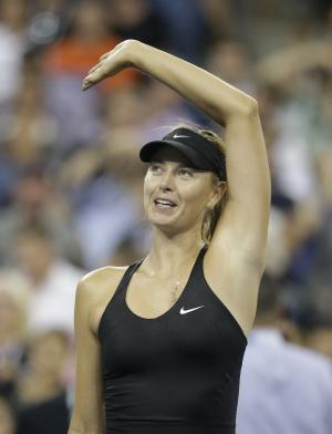 Maria Sharapova, of Russia, waves to fans after defeating Maria Kirilenko, of Russia, 6-4, 6-0 during the opening round of the U.S. Open tennis tournament Monday, Aug. 25, 2014, in New York. (AP Photo/Darron Cummings)