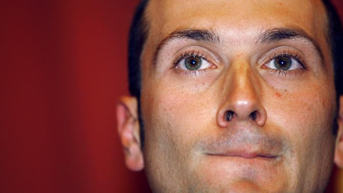 FILE - In this May 8, 2007 file photo, Giro d'Italia champion Ivan Basso attends a news conference the day after admitting involvement in a Spanish doping scandal, Milan, Italy. Seven years after Spanish investigators uncovered one of cycling's most sophisticated and widespread doping rings, some of its central figures will stand trial on Monday, Jan. 28, 2013 in the Operation Puerto case. (AP Photo/Alberto Pellaschiar, File)