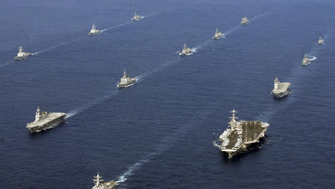 In this photo taken Nov. 16, 2012 and released by U.S. Navy, twenty-six ships from the U.S. Navy and the Japan Maritime Self-Defense Force, including USS George Washington, bottom right, steam together in East China Sea after the conclusion of Keen Sword, a biennial naval exercise by the two countries to respond to a crisis in the Asia-Pacific region. As U.S. President Barack Obama tours Asia to push his year-old pivot to the Pacific policy, the big question on everybody's mind is how much of a role Washington, with its mighty military and immense diplomatic clout, can play in keeping the Pacific. Japan is Washington's most faithful security partner in the Pacific and it is the most pinched by China's rise. (AP Photo/U.S. Navy, Chief Mass Communication Specialist Jennifer A. Villalovos) EDITORIAL USE ONLY