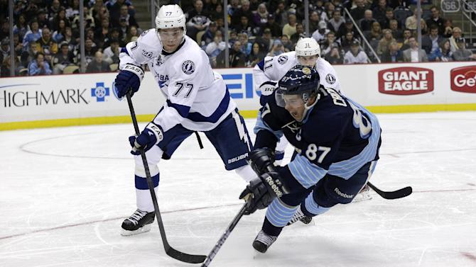 Pittsburgh Penguins center Sidney Crosby (87) gets a shot off a face off in front of Tampa Bay Lightning defenseman Victor Hedman (77) in the second period of an NHL hockey game in Pittsburgh Sunday, Feb. 24, 2013. (AP Photo/Gene J. Puskar)