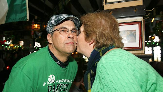 "A woman kisses her husband at the Gillette ""Kiss Me, I'm Smooth Shaven!"" festivities at McGillin's Ale House, reminding guys to K.I.S.S. - Keep It Smooth Shaven - on Sunday, March 10, 2013 in Philadelphia. A recent study revealed that 85% of women prefer to kiss a man who is smooth shaven, and that two out of three women said men will have better luck with them if they are stubble-free. (Photo by Mark Stehle/Invision for Gillette/AP Images)"