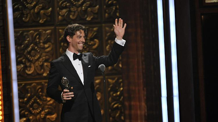 "Christian Borle accepts the award for best performance by an actor in a featured role in a play for ""Peter and the Starcatcher,"" at the 66th Annual Tony Awards on Sunday June 10, 2012, in New York. (Photo by Charles Sykes /Invision/AP)"