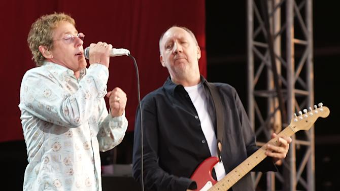 """FILE - In this July 2, 2006 file photo, Roger Daltrey and Pete Townshend of The Who are shown during their performance at the Hyde Park Music Festival, in London. Daltrey and Townshend are taking """"Quadrophenia"""" and other Who classics on the road for a U.S. tour this fall, but first plan what Daltrey calls a great finale for the Olympic Games in London. (AP Photo/ Max Nash, File)"""
