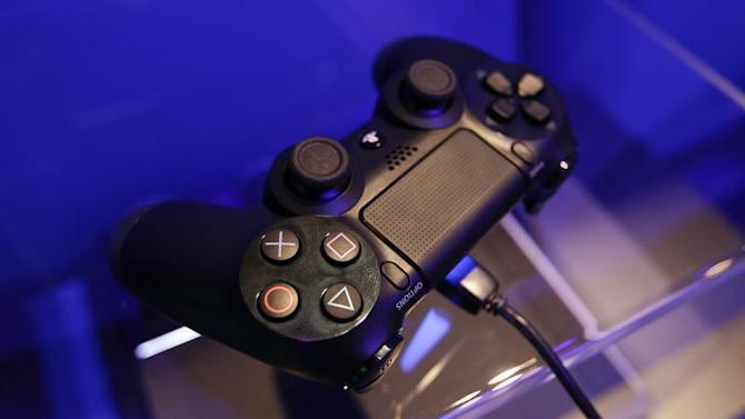 A controller of a Playstation 4 is pictured at the Sony exhibition stand during the Gamescom 2013 video games trade fair in Cologne