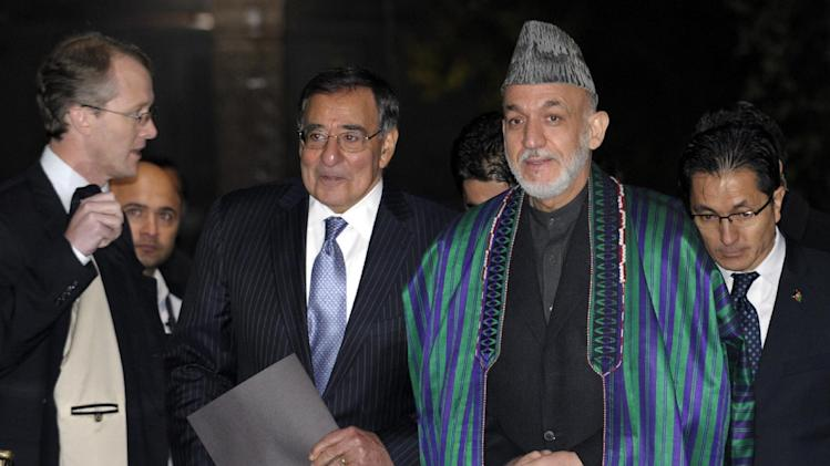 FILE - In this Dec. 13, 2012, file photo, Defense Secretary Leon Panetta and Afghanistan President Hamid Karzai arrive for their joint news conference at the Presidential Palace in Kabul, Afghanistan. U.S. commanders are offering glowing reviews of their 2012 Afghanistan war campaign. And the upbeat assessments that could be interpreted as leeway for President Barack Obama to order another round of troop withdrawals next summer.  Panetta has not yet recommended to Obama a specific pace of withdrawals for 2013. But during the Pentagon chief's two-day visit to the war zone last week, commanders suggested that things are going better than is generally believed by an American public weary of war after 11 years. (AP Photo/Susan Walsh, Pool)