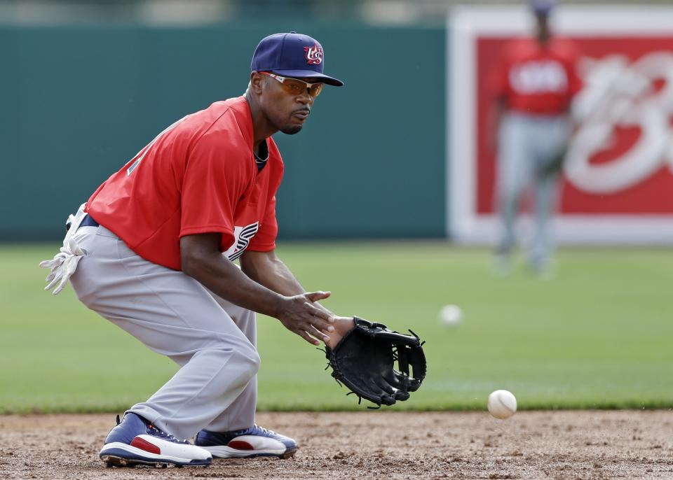 United States' Jimmy Rollins takes fielding practice before an exhibition baseball game against the Chicago White Sox Tuesday, March 5, 2013, in Glendale, Ariz. The game is the first of two exhibitions the team will play leading up the the start of the World Baseball Classic. (AP Photo/Mark Duncan)